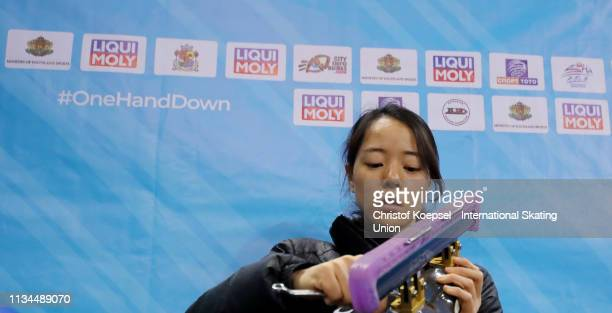 Sumire Kikuchi of Japan prepares her shoes during the ISU World Short Track Speed Skating Championships Day 1 at Armeec Arena on March 08 2019 in...