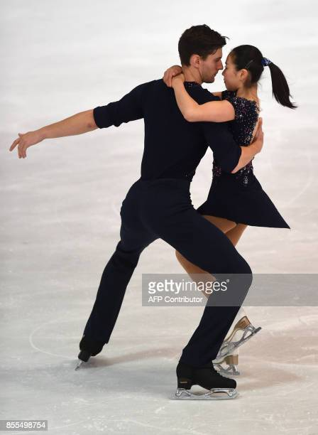Sumire Suto and Francis Boudreau-Audet from Japan perform during their pairs free skating program of the 49th Nebelhorn trophy figure skating...