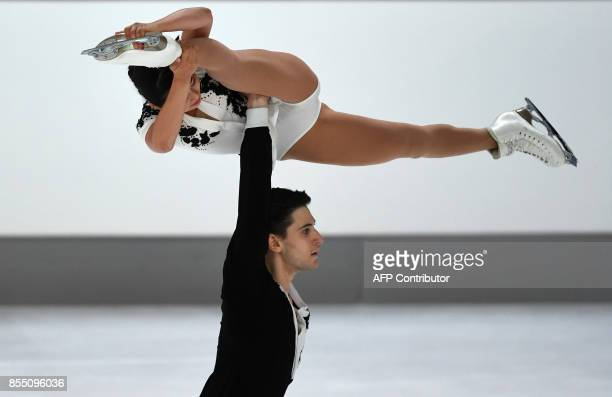 Sumire Suto and Francis Boudreau-Audet of Japan perform during their pairs short program of the 49th Nebelhorn trophy figure skating competition in...