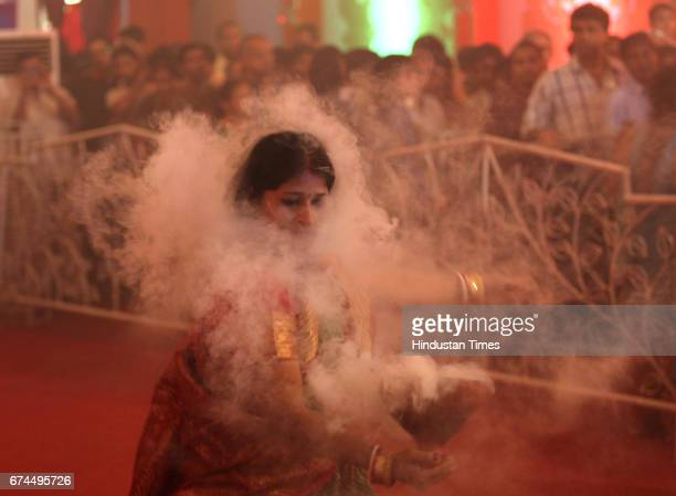 Sumitra Ghosh performed Dhunuchi dance during Durga Pooja at shivajipark in Mumbai India