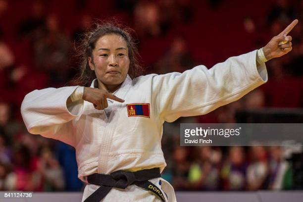 Sumiya Dorjsuren of Mongolia celebrates defeating Tsukasa Yoshida of Japan by a wazari in extra time to win the u57kg gold medal during the 2017...