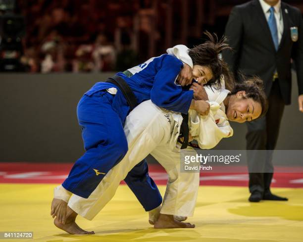 Sumiya Dorjsuren of Mongolia throws Tsukasa Yoshida of Japan for a wazari in extra time to win the u57kg gold medal during the 2017 Suzuki World Judo...