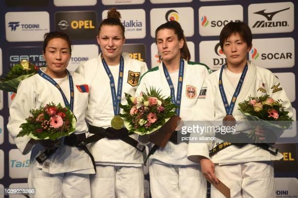 Sumiya Dorjsuren Theresa Stoll Jovana Rogic and Nae Udaka celebrate after competing in the 57 kilo category at the Judo Grand Prix in the Mitsubishi...