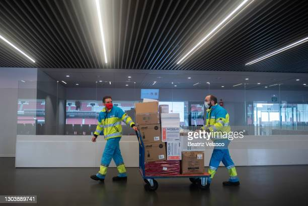 Summa 112 workers transport the material for the Covid-19 vaccination at the Wanda Metropolitan Stadium on February 24, 2021 in Madrid, Spain. The...