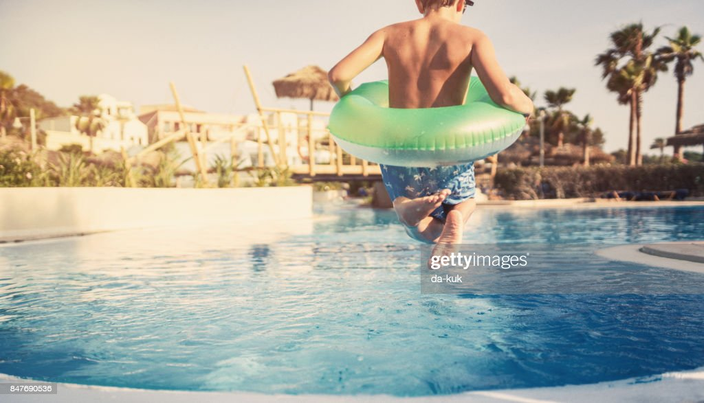 Summer activities in the swimming pool : Stock Photo