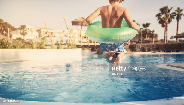 summer activities in the swimming pool - standing water stock pictures, royalty-free photos & images
