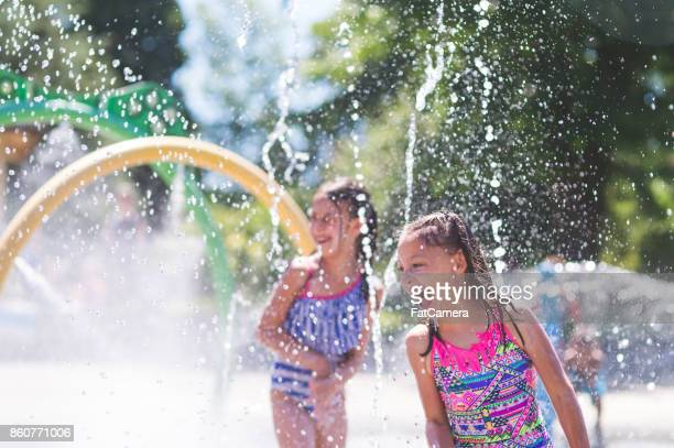 summer afternoon at the splash pad - fountain stock pictures, royalty-free photos & images