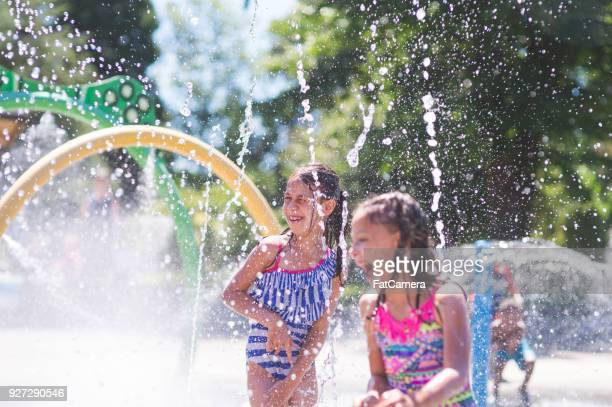 summer afternoon at the splash pad - geographical locations stock pictures, royalty-free photos & images
