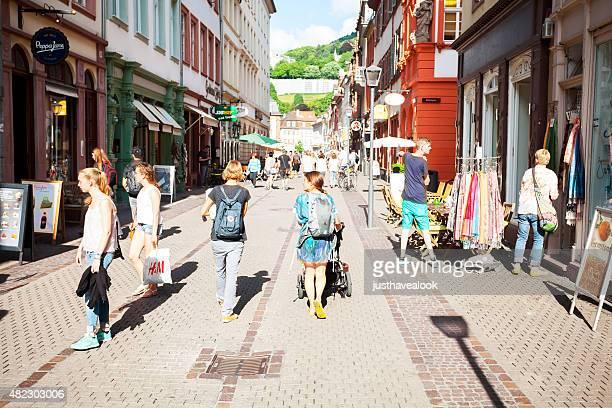 summer afternoon scene in pedestrian zone hauptstraße of heidelberg - hauptstraße stock pictures, royalty-free photos & images
