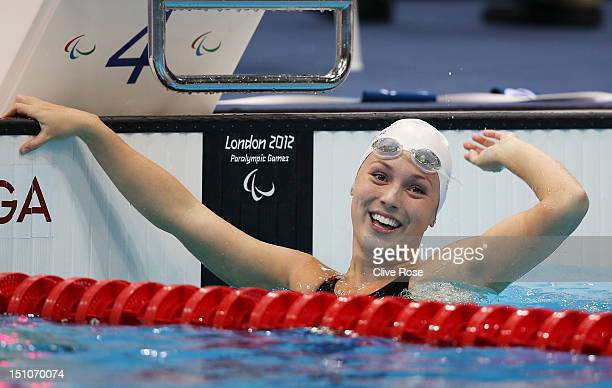 Summer Ashley Mortimer of Canada celebrates after winning gold in the Women's 50m Freestyle S10 Final on day 2 of the London 2012 Paralympic Games at...