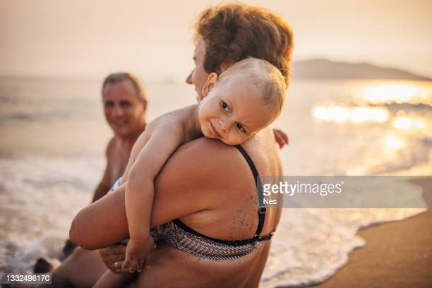 summer at sea with grandparents - sea swimming stock pictures, royalty-free photos & images