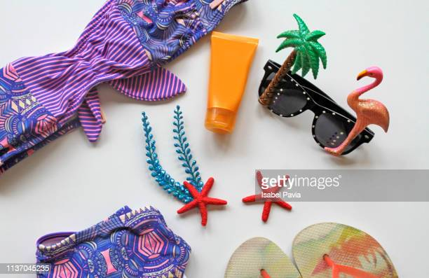 summer beach accessories on white background. summer concept - monokini photos et images de collection