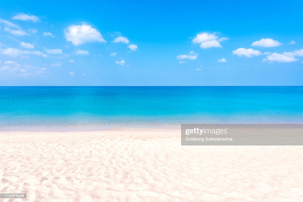 Summer beach background. Sand and sea and blue sky : Foto stock