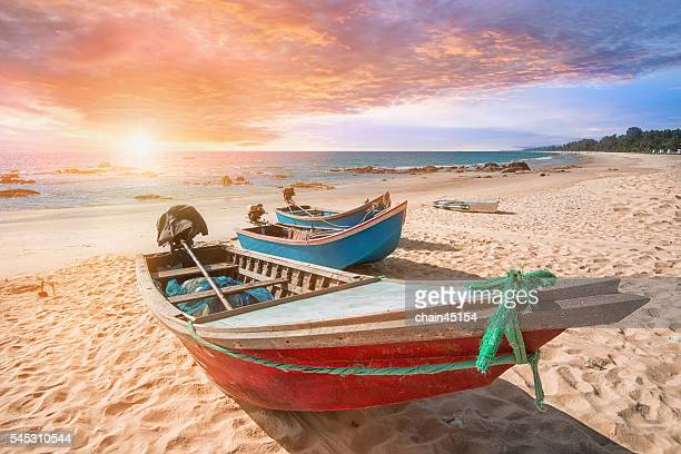 Summer beach in Krabi beach, with the boat during sunset at Thailand