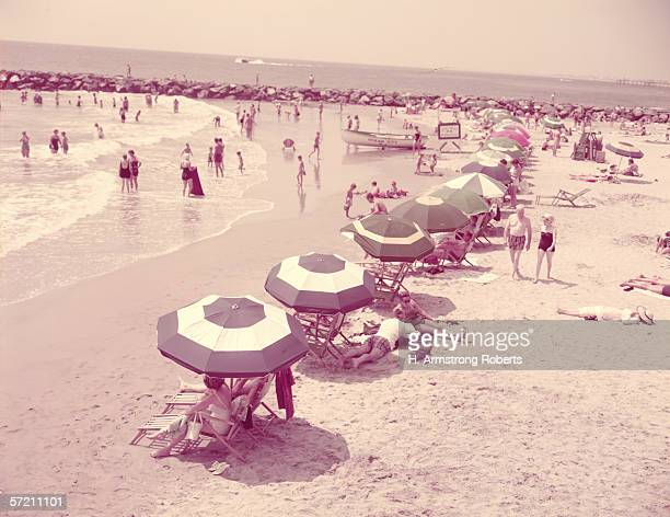 Summer beach scene people relaxing on sandy shore New Jersey