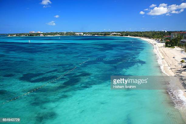 summer beach time! - cable beach bahamas stock photos and pictures