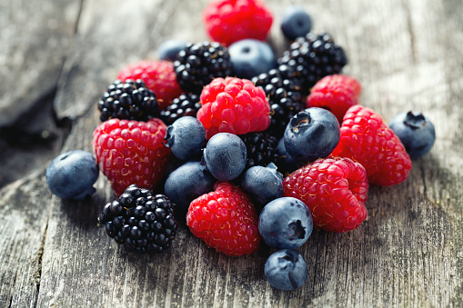 summer berries on wooden surface 489662264