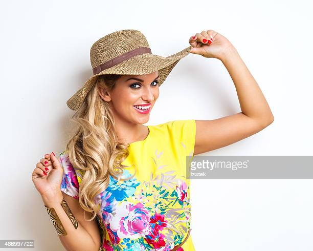 summer blonde woman wearing yellow dress - floral pattern dress stock pictures, royalty-free photos & images