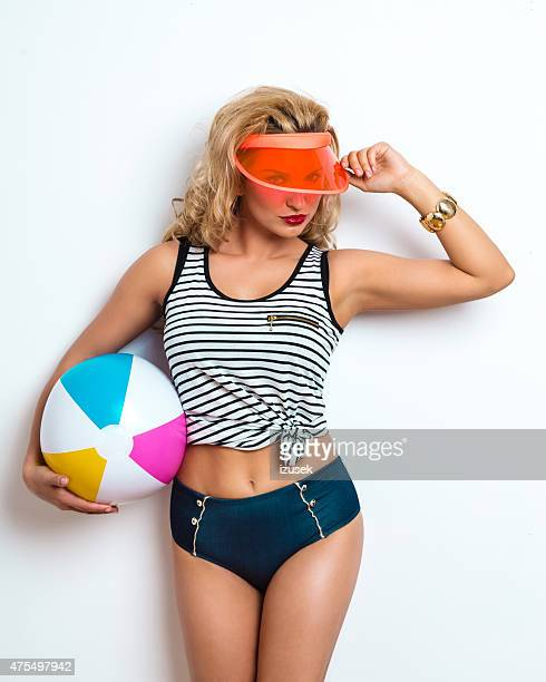 Summer Blonde Young Woman holding beachball