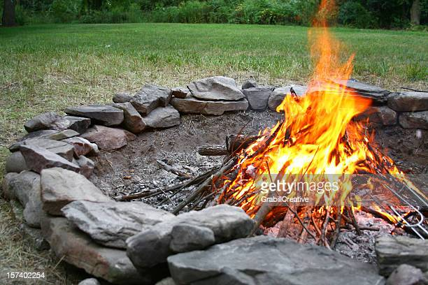 summer bonfire in stone fire pit - fire pit stock pictures, royalty-free photos & images