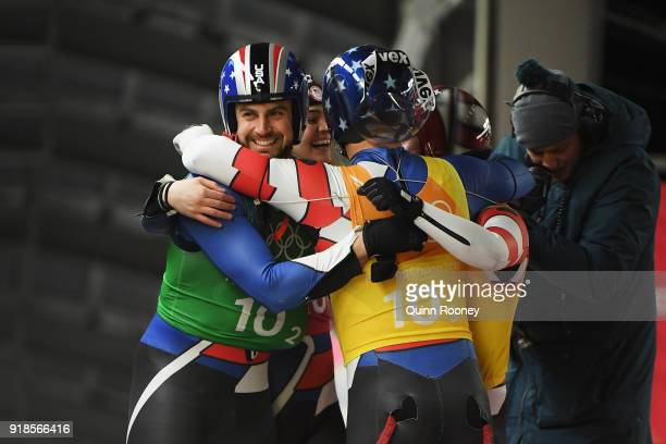 Summer Britcher Chris Mazdzer Matthew Mortensen and Jayson Terdiman of the United States celebrate after a run during the Luge Team Relay on day six...