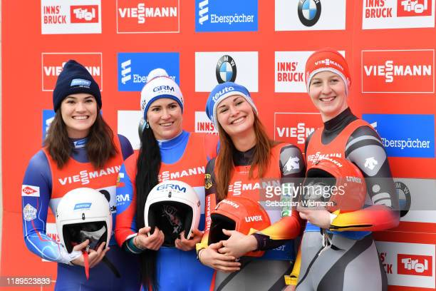 Summer Britcher of USA Tatyana Ivanova of Russia Julia Taubitz of Germany and Jessica Tiebel of Germany smile after their second run of the Women's...