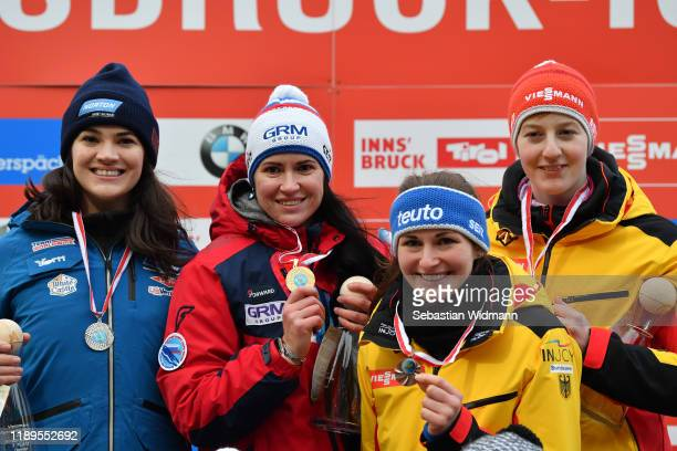 Summer Britcher of USA Tatyana Ivanova of Russia Julia Taubitz of Germany and Jessica Tiebel of Germany pose at the medal ceremony during the FIL...
