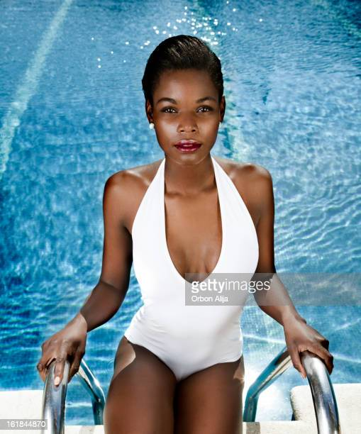 summer by the pool - skinny black woman stock photos and pictures