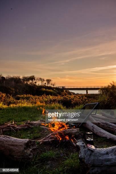 summer campfire by the Putangirua streambed at sunset, Wairarapa