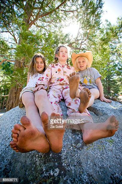Summer camping, 3 girls with dirty feet