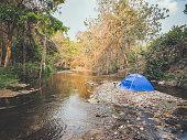 summer camping tent near stream
