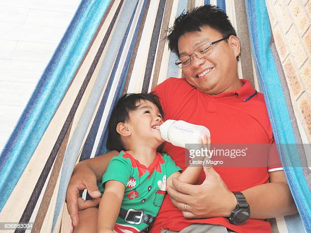 Summer Christmas - toddler and dad in the hammock