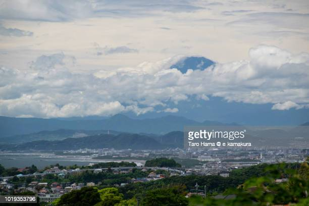 Summer clouds on Mt. Fuji, Sagami Bay and Hiratsuka, Chigasaki and Fujisawa cities in Kanagawa prefecture in Japan