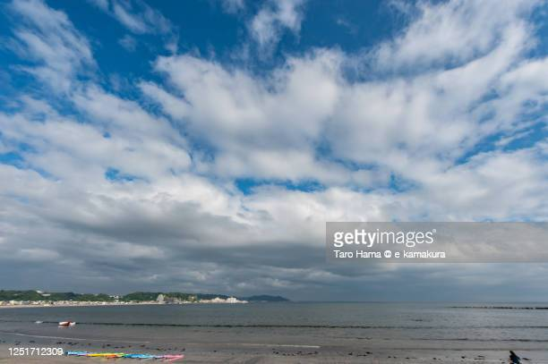 summer clouds on the beach in kanagawa prefecture of japan - taro hama ストックフォトと画像