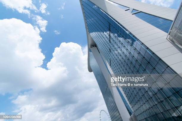 Summer clouds reflecting on the window of Marina Bay Sands in Singapore