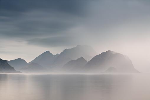 Summer cloudy Lofoten islands. Norway misty fjords. 626590396
