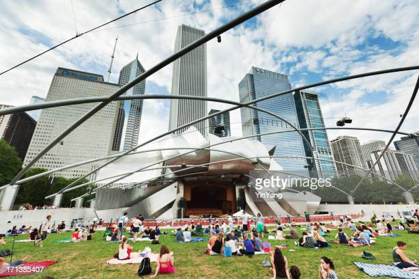 summer concert at the millennium park in downtown chicago - millenium park stock photos and pictures