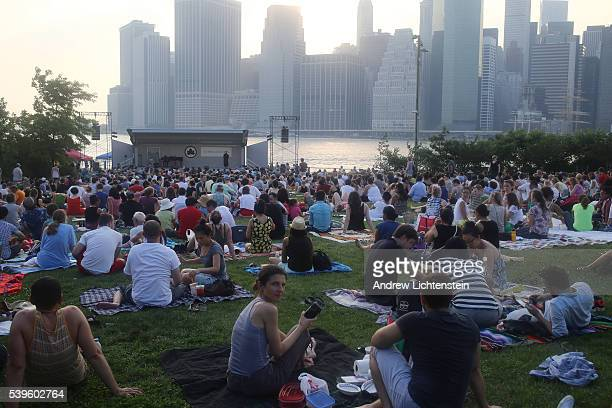 Summer concert audience waits for a free opera to begin at the newly constructed Pier One in the Brooklyn Bridge Park,