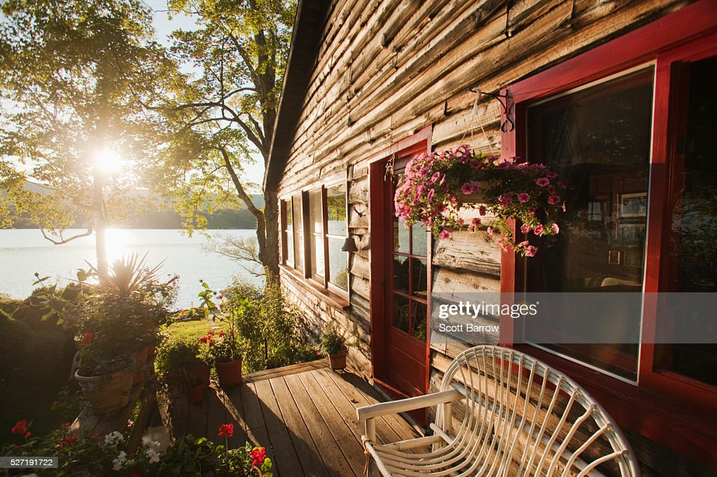 Summer cottage beside a lake : ストックフォト