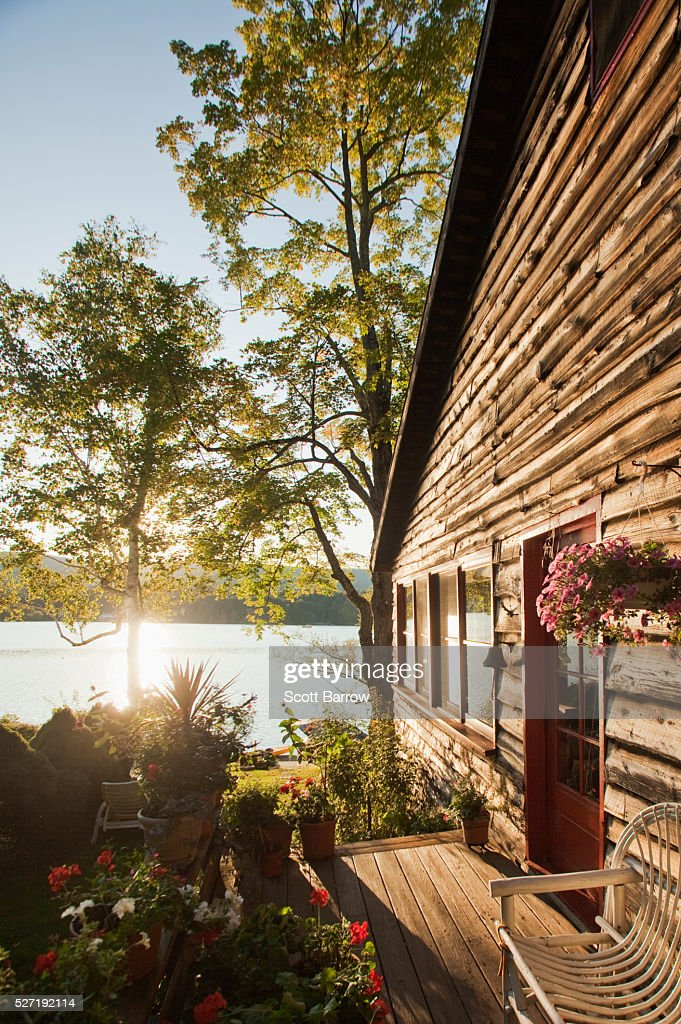 Summer cottage beside a lake : Stock Photo