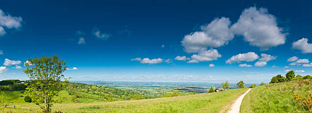 Summer countryside panorama big blue sky lush green landscape