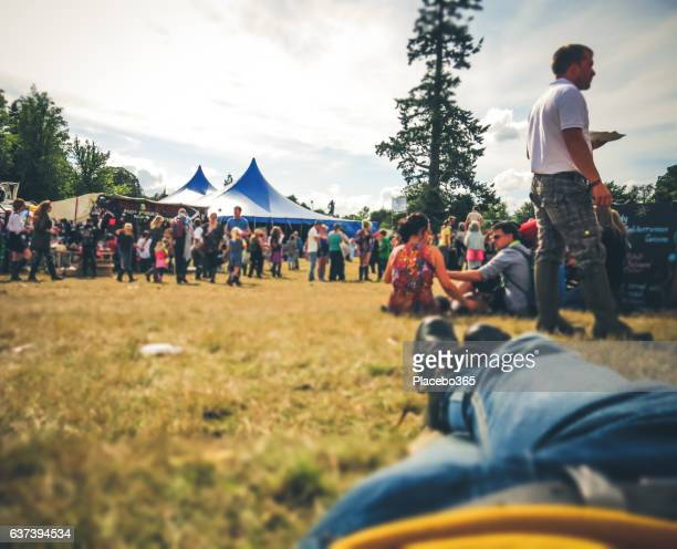 summer crowd of people festival celebration resting point of view - music festival stock pictures, royalty-free photos & images