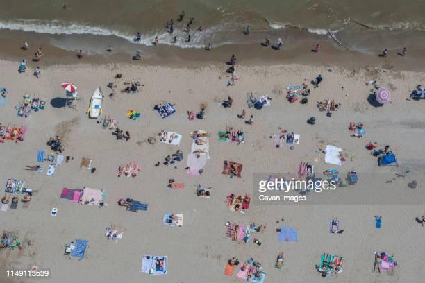 summer day, bradford beach, lake michigan, milwaukee, wisconsin. - melanoma stock pictures, royalty-free photos & images