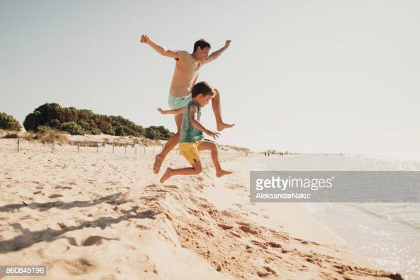summer day on the beach - family vacation stock pictures, royalty-free photos & images