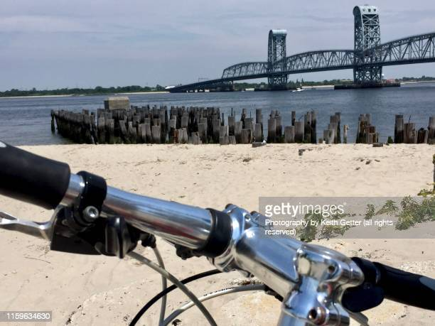 summer day road trip by bicycle to breezy point, queens nyc - rockaway peninsula stock pictures, royalty-free photos & images