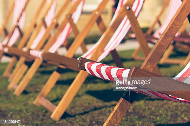 Summer deck chairs on grass