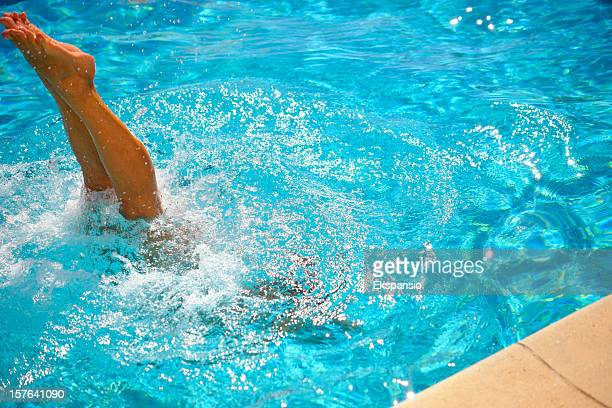 summer dive in sunshine with splash into swimming pool - skinny dipping stock photos and pictures