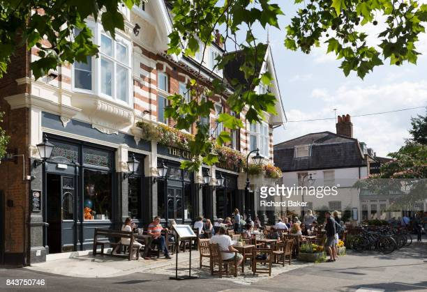 Summer drinkers enjoy a warm Sunday afternoon outside the newly refurbished Crown and Greyhound pub in Dulwich Village on 2nd September 2017 in south...