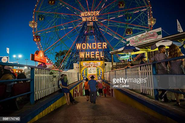 summer evening at luna park on coney island - coney island stock pictures, royalty-free photos & images