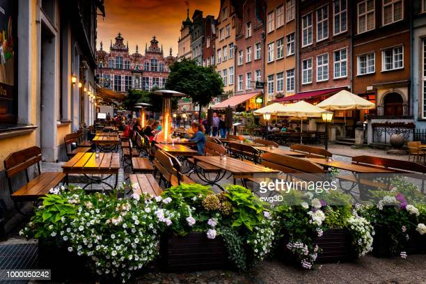 a summer evening on piwna street in gdansk, poland - gdansk stock pictures, royalty-free photos & images